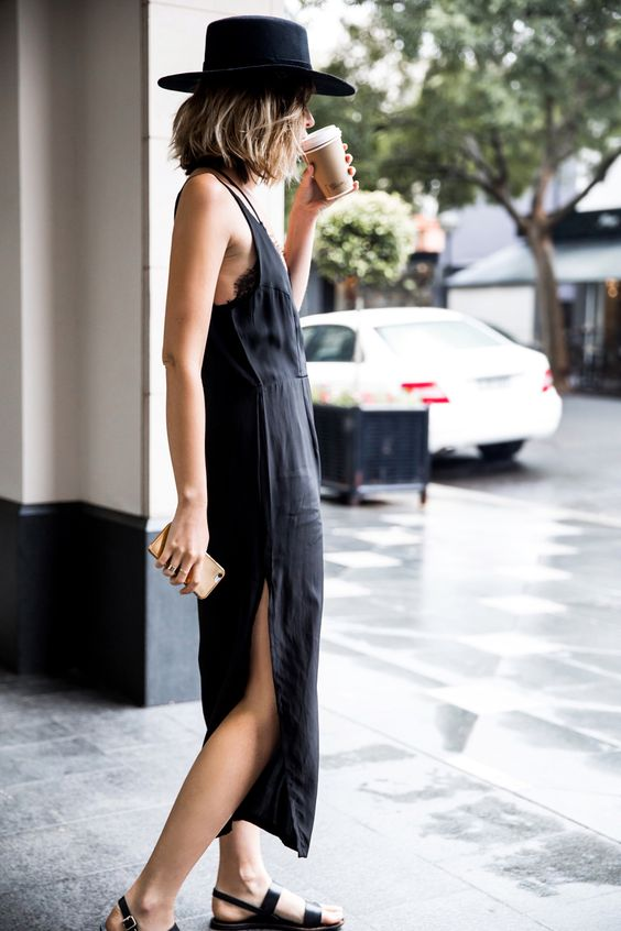 black slip dress with cutouts and black sandals