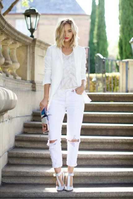 ripped white jeans, a white top, a white jacket and t strap white heels