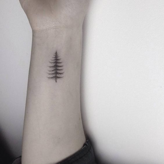 31 small hand tattoos that will make you want one for Pine tree tattoo ideas