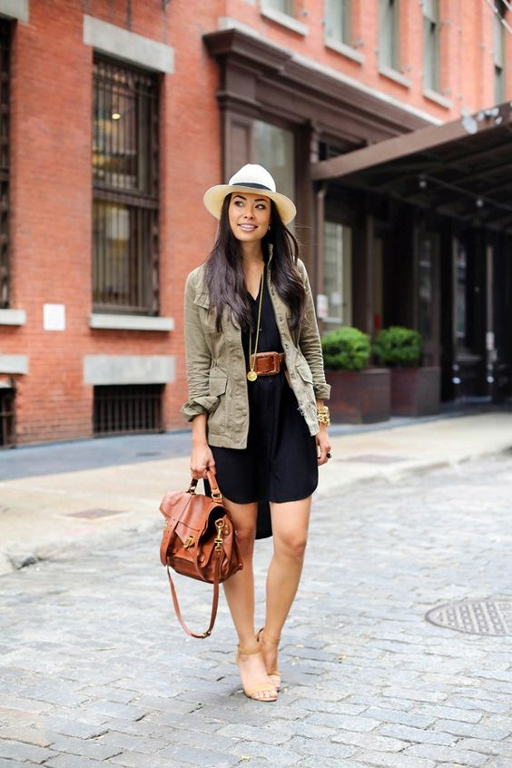 a black shirt dress, a military jacket, nude heels and a tan bag