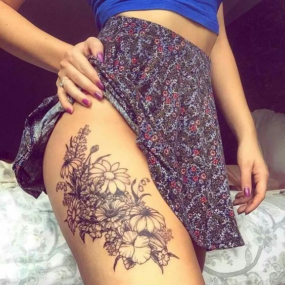 black flower thigh tattoo