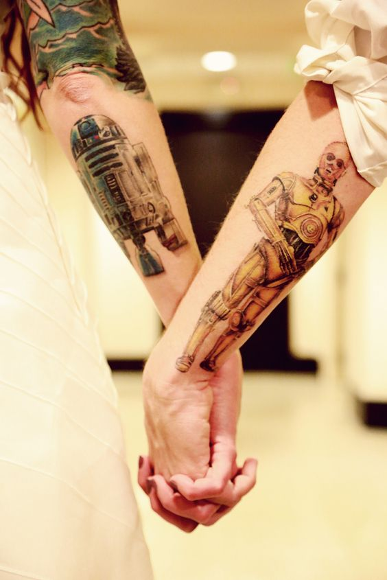 couple Star Wars themed tattoos on arms