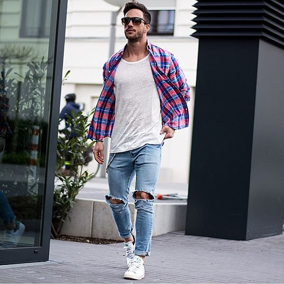 distressed jeans, a white tee, a checked shirt and white sneakers