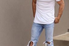 17 light blue distressed jeans, a white t-shirt and black sneakers