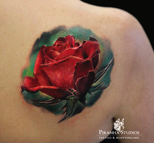 realistic red rose tattoo on a shoulder
