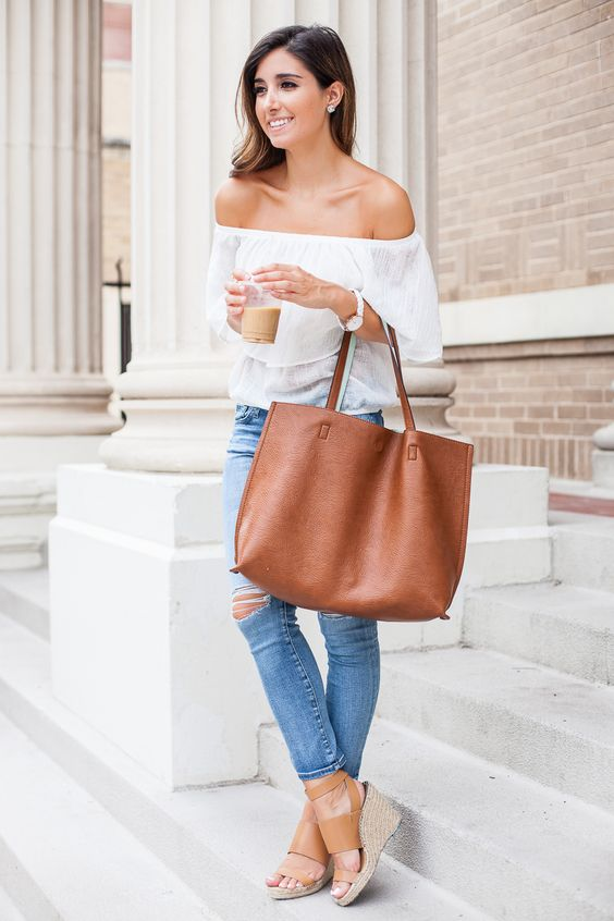 17 ripped jeans, a white off the shoulder blouse and tan wedges