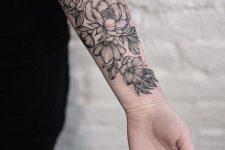 18 black flowers arm tattoo