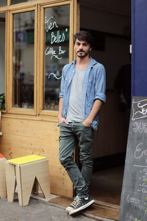 green jeans, a grey tee, a denim shirt and black Converse