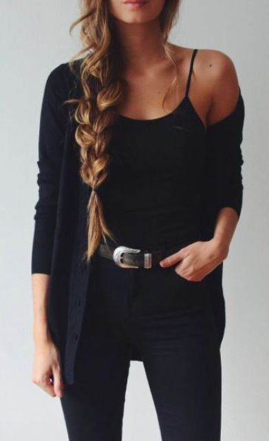 black jeans, a black spaghetti straps top and a black cardigan