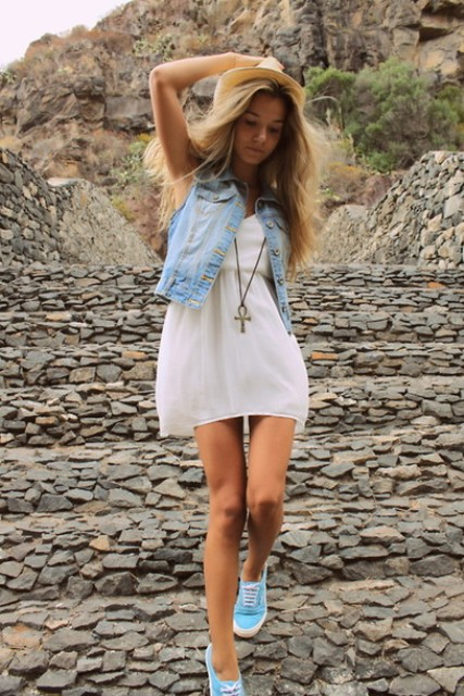 white mini dress, a denim vest with blue Vans