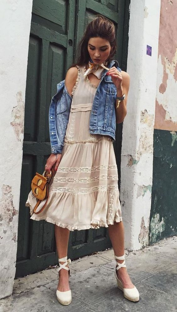21 a frilly dress paired with a denim jacket and lace-up espadrilles.