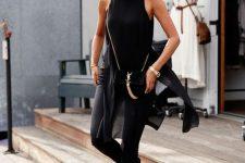 21 black pants, a black sheer top and black heels