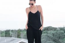 22 black pants, a black spaghetti strap top and sandals