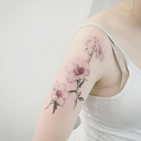 delicate botanical flower tattoo
