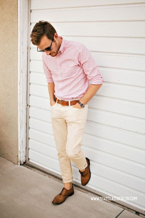 Picture Of white trousers, a pink shirt and brown shoes without socks