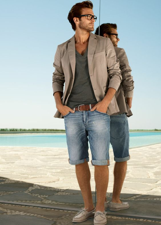 23 bermuda denim shorts, an olive green tee, a brown jacket and sneakers
