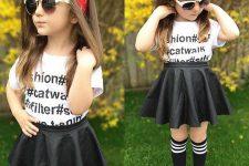 23 black skirt, a printed tee and black sneakers