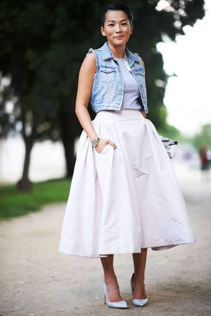 full midi white skirt, a grey top and a denim vest