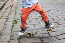 23 orange sport pants, a blue tee and black sneakers