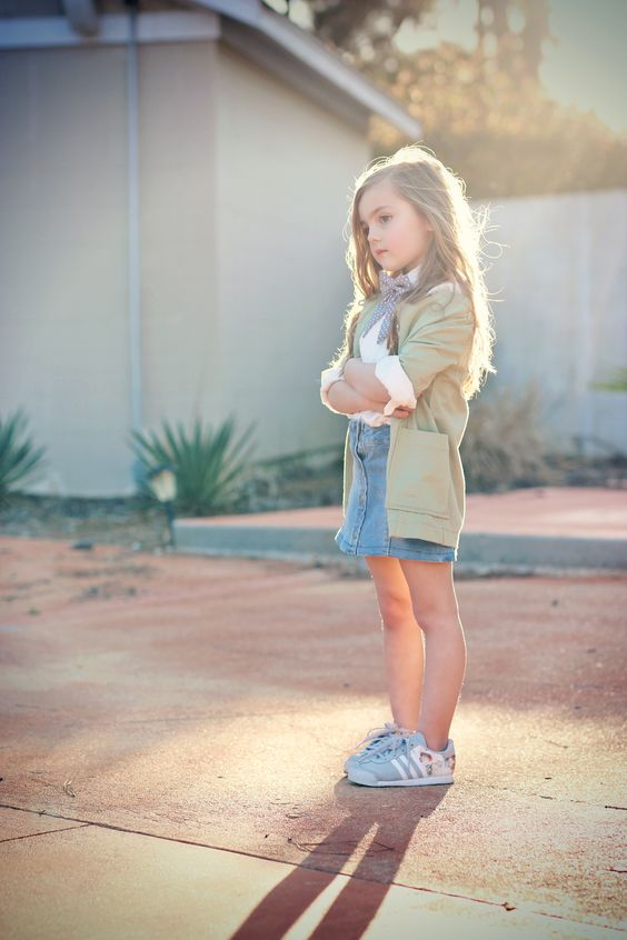 denim skirt, a white shirt and blue sneakers