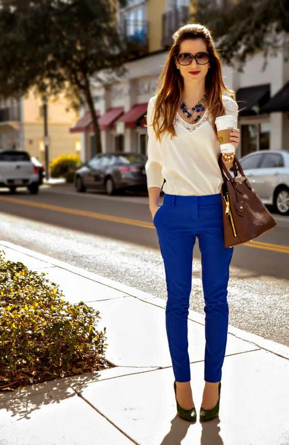 Picture Of ivory lace blouse and royal blue trousers with green shoes
