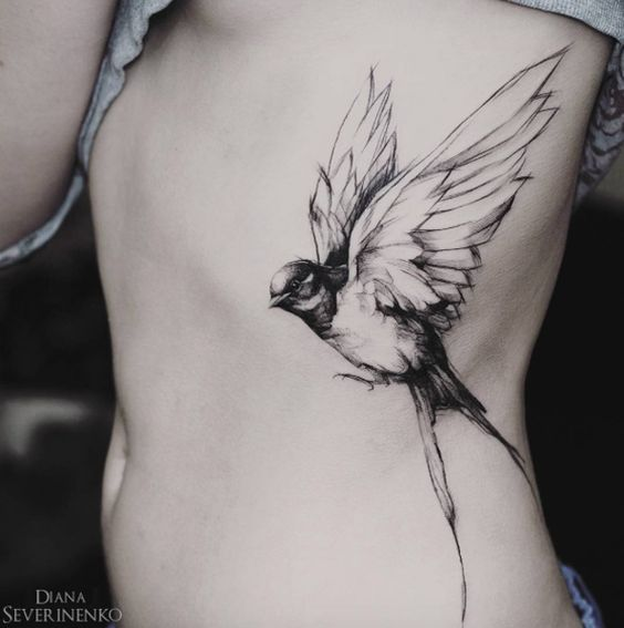 large songbird tattoo on the body