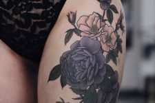 24 moody dark flower thigh tattoo