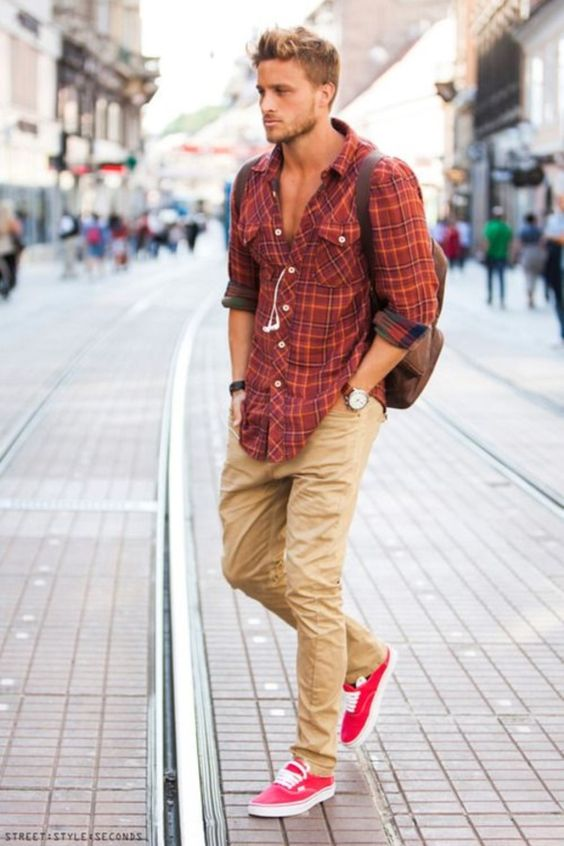 tan pants, a red checked shirt and red vans