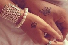 25 matching couple crown tattoos on hands
