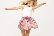 25 printed skirt, a white lace top and white converse