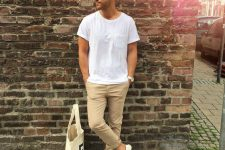 25 tan pants, a white tee and white Vans shoes