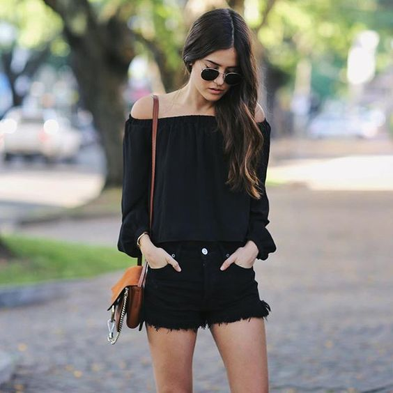 black denim shorts, an off the shoulder top