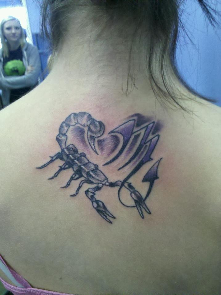 Zodiac inspired back tattoo