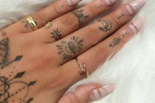 27 multiple hand tattoos