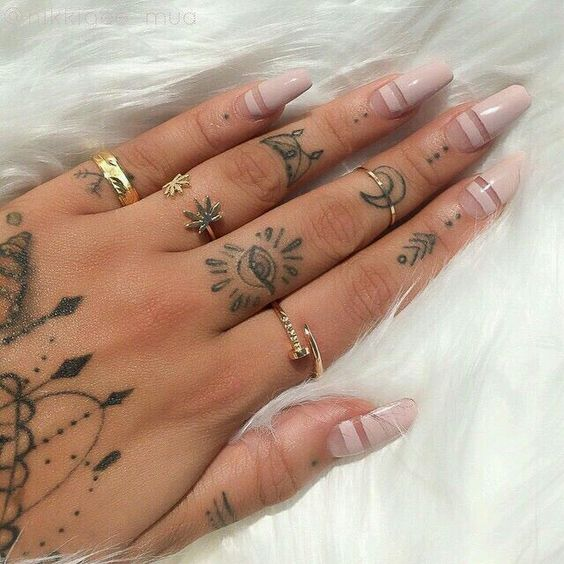 multiple hand tattoos