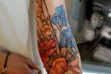 30 super bold floral arm tattoo