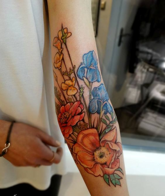 super bold floral arm tattoo