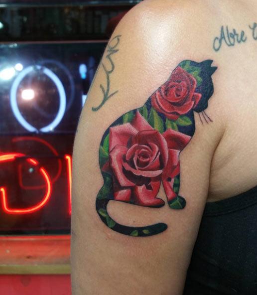 cat roses tattoo