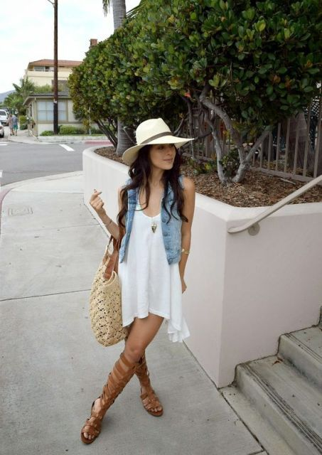 With loose dress and wide brim hat
