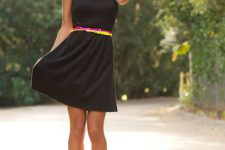 Look with black dress and contrasting belts
