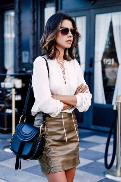 Look with leather lace up skirt and white blouse