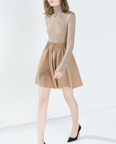 This beautiful skirt has such gorgeous retro vibes - it's perfect for homecoming celebrations and fall tailgating! Featuring a classic beige color paired with a line of antique gold snap buttons down the front, this classic look is so chic!