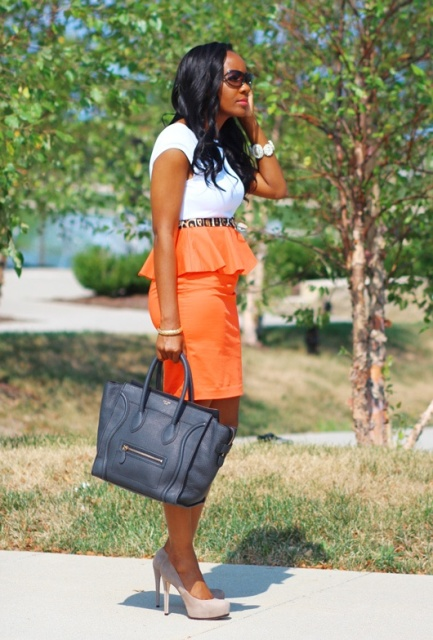 Orange skirt with white t shirt, printed belt and neutral shoes