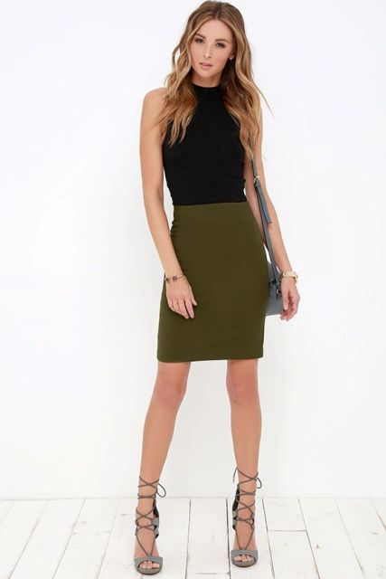 Outfit with olive green skirt, black shirt and lace up heels