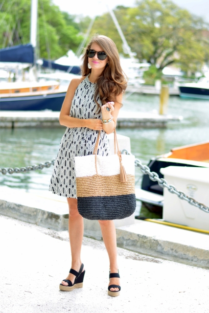 Printed dress with colored straw bag