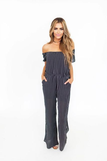 Striped black and white jumpsuit with white shoes