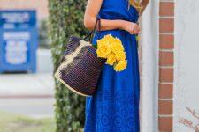 Super cool bag with maxi blue dress