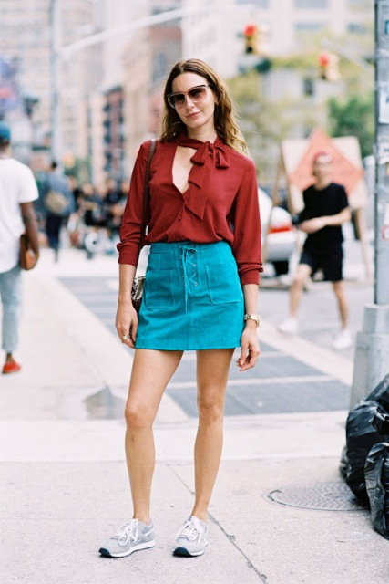 Trendy outfit with bright lace up skirt and blouse