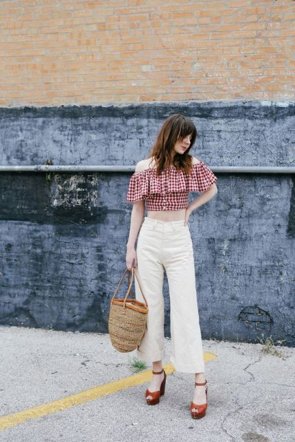 Trendy outfit with off the shoulder ruffle blouse, white jeans and bag