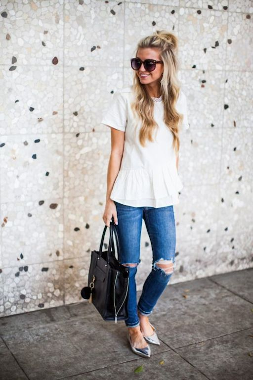 Very stylish look with distressed jeans, black big bag and white shirt